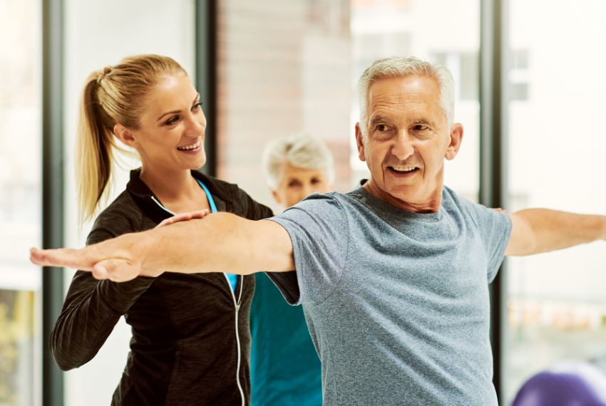 Elderly Man with fitness instructor