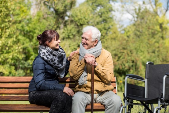 Caring for elderly man in the park