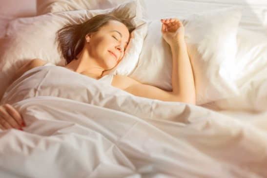 Middle Aged Woman Sleeping Happily in Bed